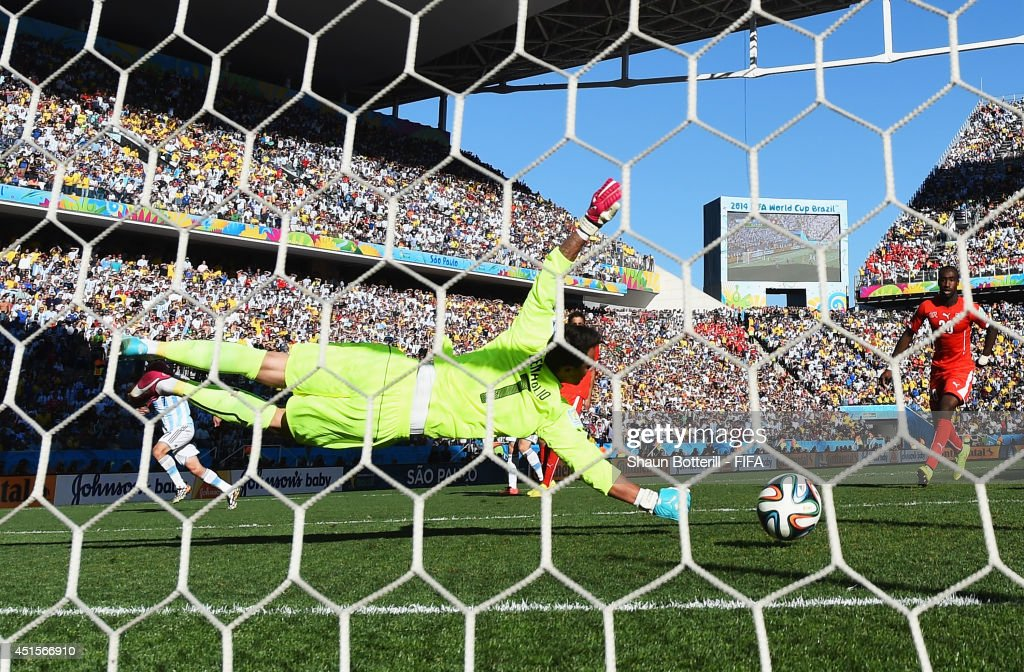 Angel di Maria (1st L) of Argentina scores his team's first goal past Diego Benaglio of Switzerland during the 2014 FIFA World Cup Brazil Round of 16 match between Argentina and Switzerland at Arena de Sao Paulo on July 1, 2014 in Sao Paulo, Brazil.