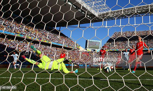 Angel di Maria of Argentina scores is team's first goal past Diego Benaglio of Switzerland in extra time during the 2014 FIFA World Cup Brazil Round...