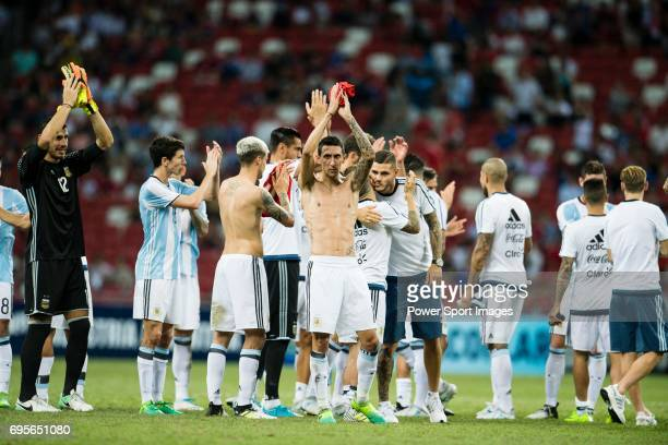 Angel Di Maria of Argentina shirtless celebrating after winning the match during the International Test match between Argentina and Singapore at...