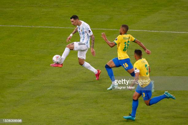 Angel Di Maria of Argentina shoots on target to score the the first goal of his team during the final of Copa America Brazil 2021 between Brazil and...
