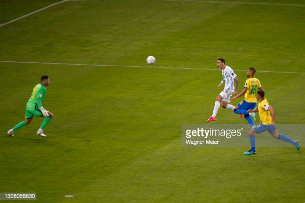Angel Di Maria of Argentina shoots on target to score the the first goal of his team against Ederson of Brazil during the final of Copa America...