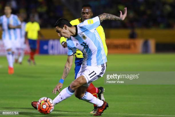 Angel Di Maria of Argentina struggles for the ball with Alex Ibarra of Ecuador during a match between Ecuador and Argentina as part of FIFA 2018...
