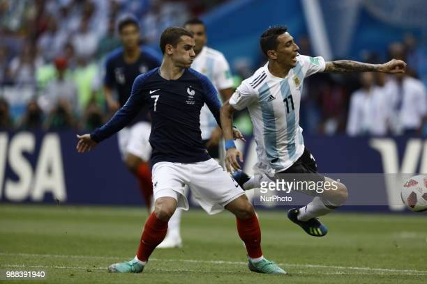 Angel Di Maria of Argentina vies Antoine Griezmann of France team during the 2018 FIFA World Cup Russia Round of 16 match between France and...