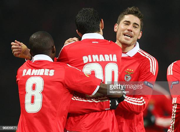 Angel Di Maria of Lisbon jubilates with team mates after scoring the first goal during the UEFA Europa League knock-out round, first leg match...
