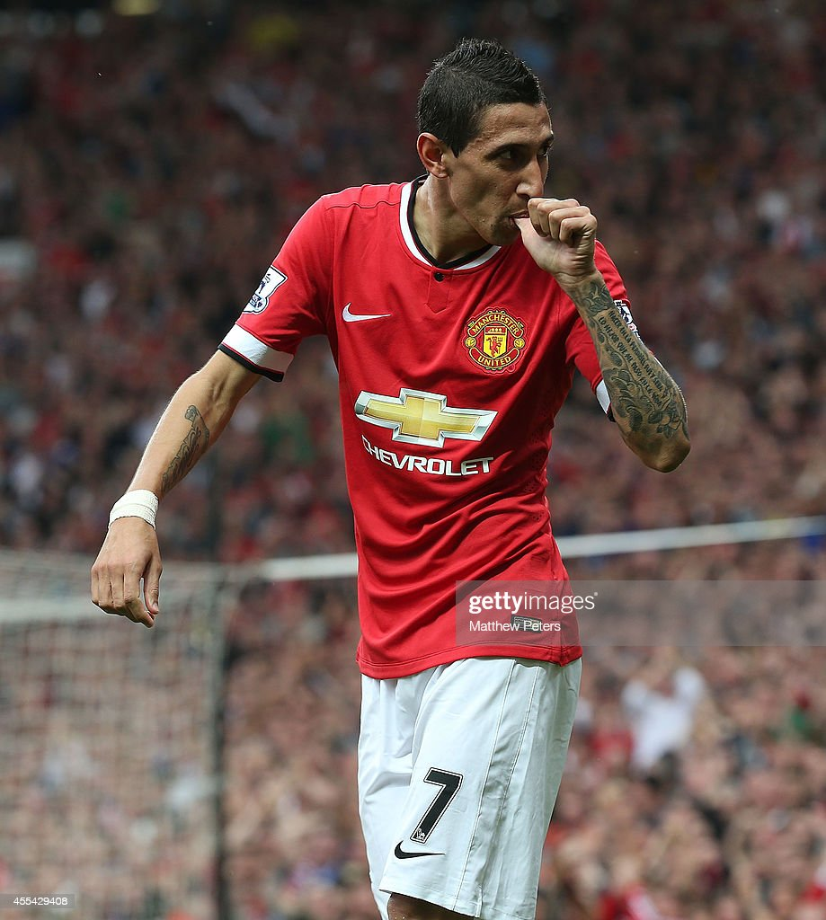 Angel di Maria of Manchester United celebrates scoring their first goal during the Barclays Premier League match between Manchester United and Queens Park Rangers at Old Trafford on September 14, 2014 in Manchester, England.