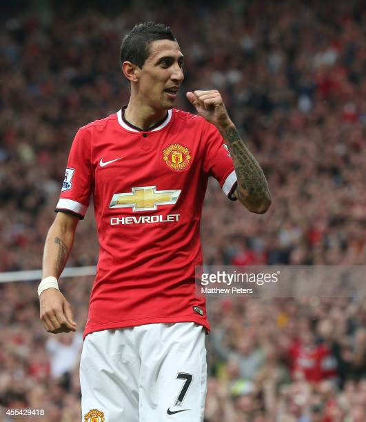 Angel di Maria of Manchester United celebrates scoring their first goal during the Barclays Premier League match between Manchester United and Queens...