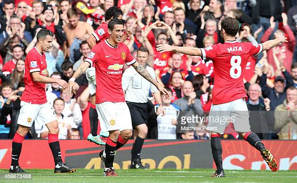 Angel di Maria of Manchester United celebrates scoring their first goal during the Barclays Premier League match between Manchester United and...