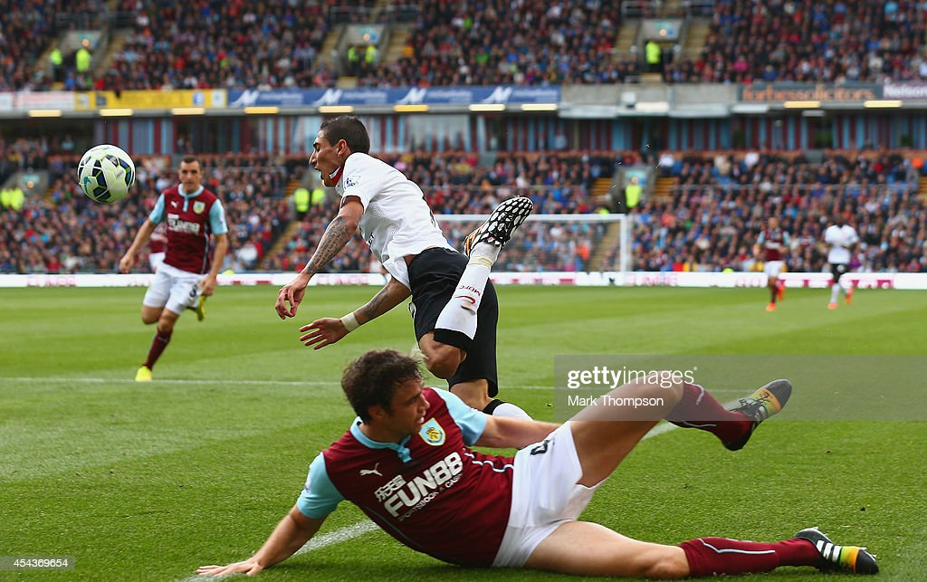 Angel di Maria of Manchester United clashes with Michael Duff of Burnley during the Barclays Premier League match between Burnley and Manchester United at Turf Moor on August 30, 2014 in Burnley, England.
