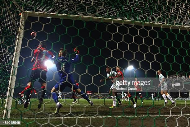 Angel Di Maria of Manchester United heads clear on the goalline as goalkeeper David De Gea covers during the FA Cup Third Round match between Yeovil...