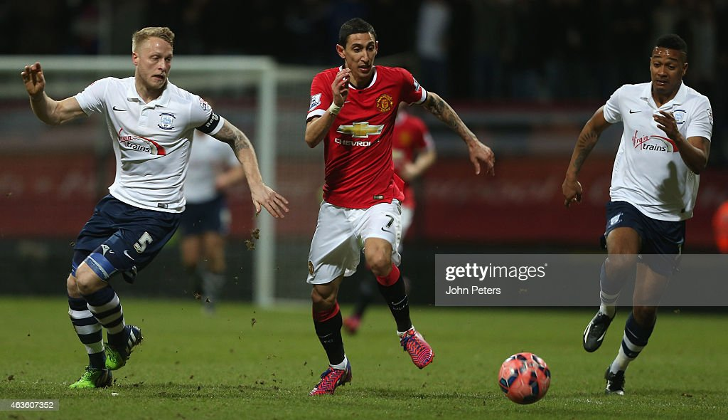 Angel di Maria of Manchester United in action with Tom Clarke and Chris Humphrey of Preston North End during the FA Cup Fifth Round match between Preston North End and Manchester United at Deepdale on February 16, 2015 in Preston, England.