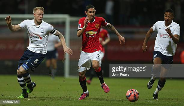 Angel di Maria of Manchester United in action with Tom Clarke and Chris Humphrey of Preston North End during the FA Cup Fifth Round match between...