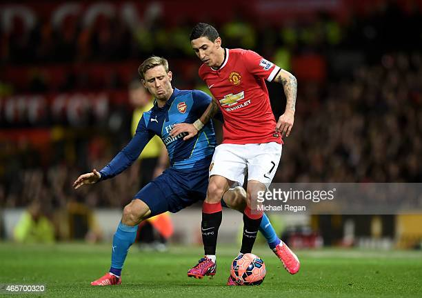 Angel di Maria of Manchester United is challenged by Nacho Monreal of Arsenal during the FA Cup Quarter Final match between Manchester United and...