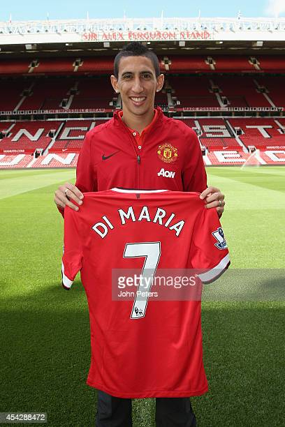 Angel di Maria of Manchester United poses with his new shirt number ahead of a press conference to unveil him at Old Trafford on August 28 2014 in...