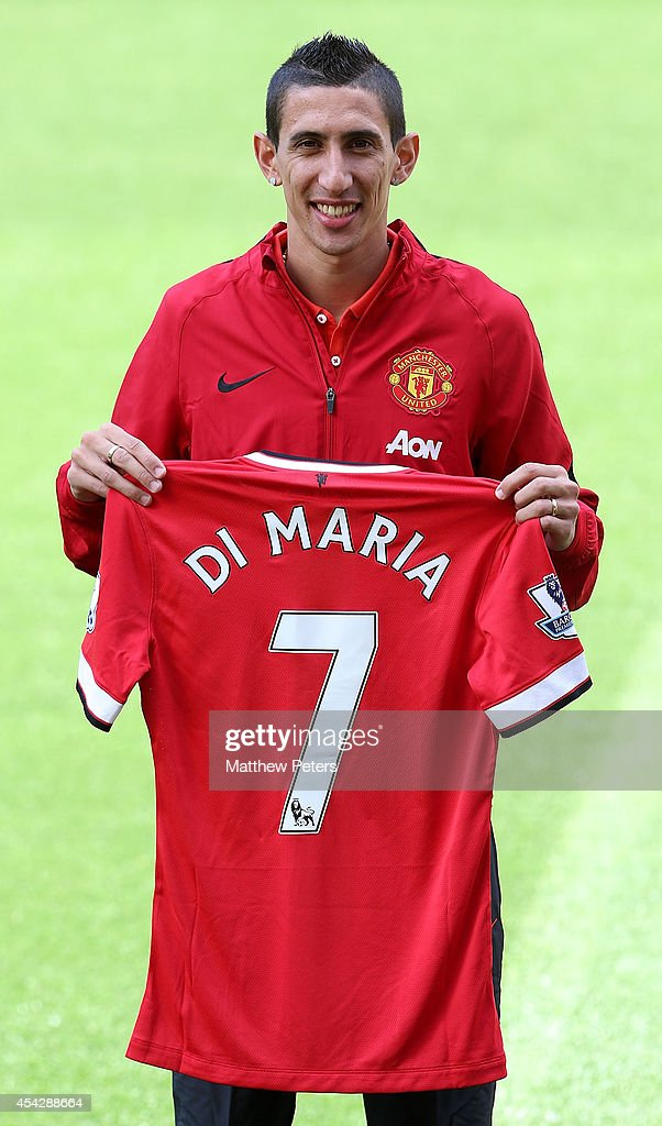 Angel di Maria of Manchester United poses with his new shirt number ahead of a press conference to unveil him at Old Trafford on August 28, 2014 in Manchester, England.