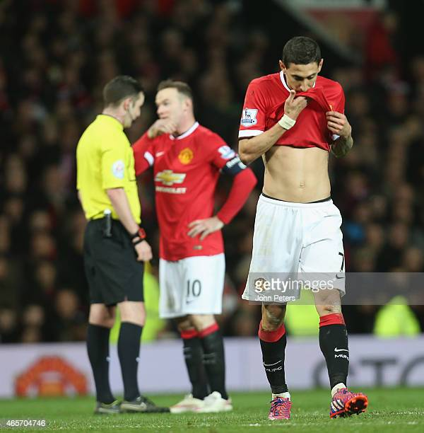 Angel di Maria of Manchester United walks off after being sent off during the FA Cup Quarter Final match between Manchester United and Arsenal at Old...