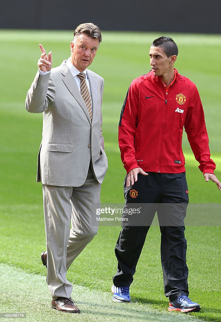 Angel di Maria of Manchester United walks with manager Louis van Gaal ahead of a press conference to unveil him at Old Trafford on August 28, 2014 in Manchester, England.
