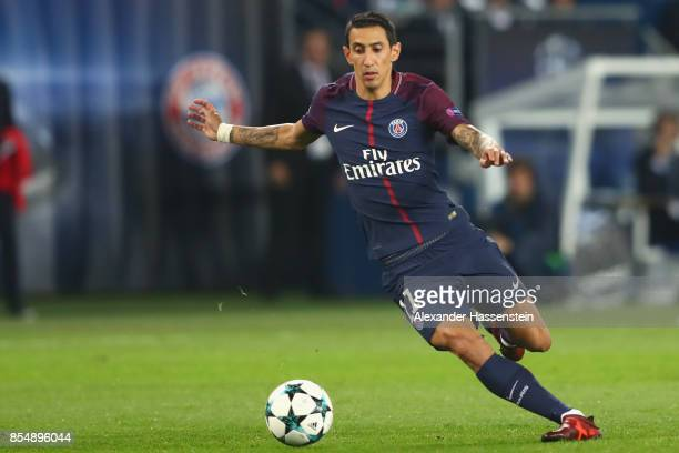 Angel Di Maria of Paris runs with the ball during the UEFA Champions League group B match between Paris SaintGermain and Bayern Muenchen at Parc des...