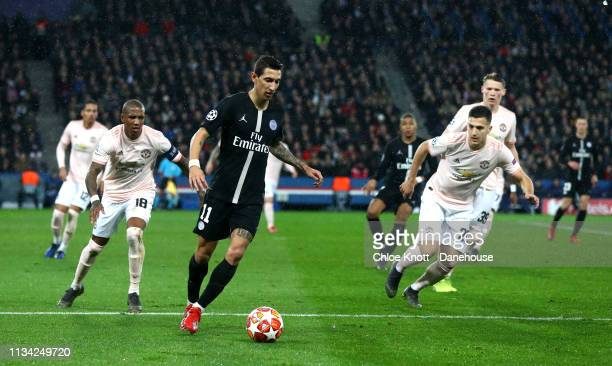 Angel Di Maria of Paris Saint Germain and Ashley Young Chris Smalling Diogo Dalot and Scott Mctominay of Manchester United in action during the UEFA...