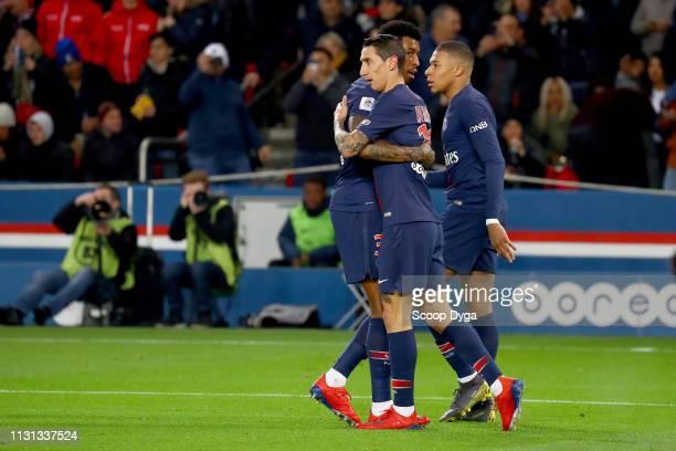 Angel Di Maria of Paris Saint Germain and Presnel Kimpembe of Paris Saint Germain during the Ligue 1 match between Paris Saint Germain and Marseille...