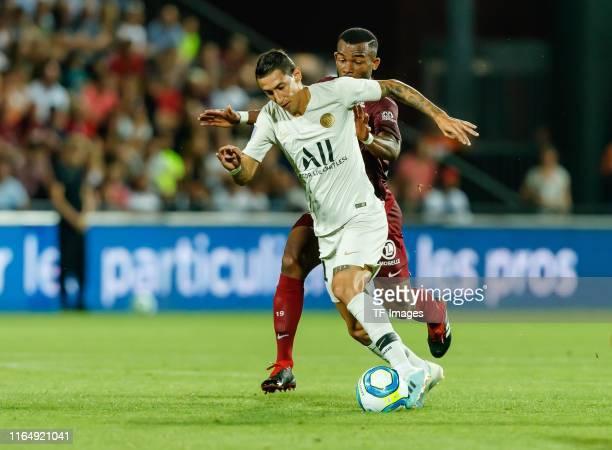 Angel Di Maria of Paris SaintGermain and Habib Maiga of FC Metz battle for the ball during the Ligue 1 match between FC Metz and Paris SaintGermain...