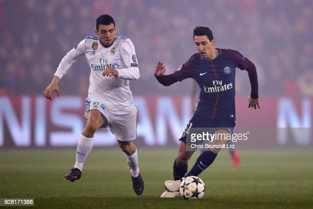 Angel Di Maria of Paris SaintGermain and Mateo Kovacic of Real Madrid in action during the UEFA Champions League Round of 16 Second Leg match between...