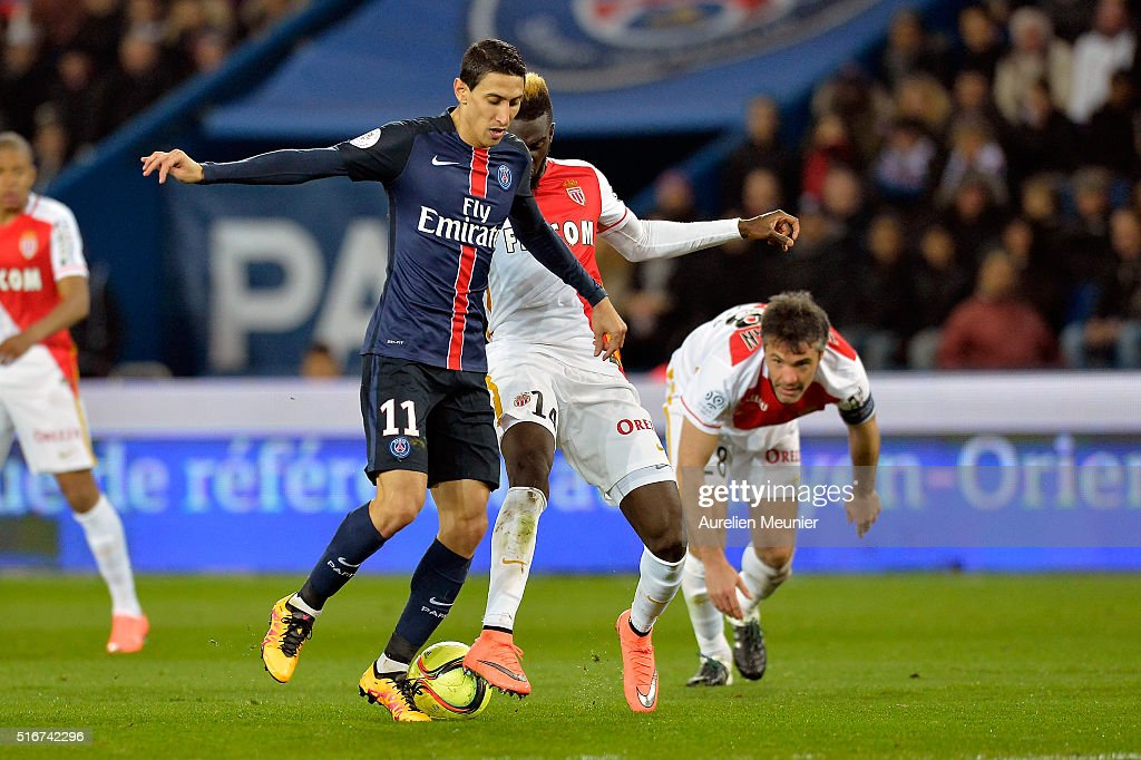 Angel Di Maria of Paris Saint-Germain and Tiemoue Bakayako of AS Monaco fight for the ball during the French Ligue 1 match between Paris Saint-Germain and AS Monaco at Parc des Princes on March 20, 2016 in Paris, France.