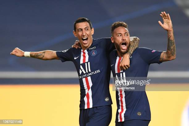 Angel Di Maria of Paris SaintGermain celebrates with Neymar after scoring his team's second goal during the UEFA Champions League Semi Final match...