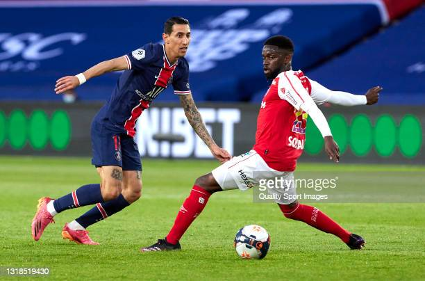 Angel Di Maria of Paris Saint-Germain competes for the ball with Moreto Cassama of Stade Reims during the Ligue 1 match between Paris Saint-Germain...