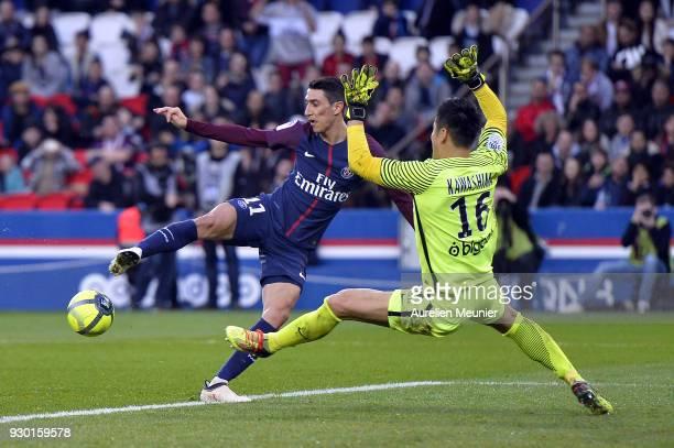 Angel Di Maria of Paris SaintGermain faces Metz goal keeper Eiji Kawashima during the Ligue 1 match between Paris Saint Germain and Metz at Parc des...
