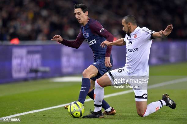 Angel Di Maria of Paris SaintGermain fights for the ball during the Ligue 1 match between Paris Saint Germain and Dijon FCO at Parc des Princes on...