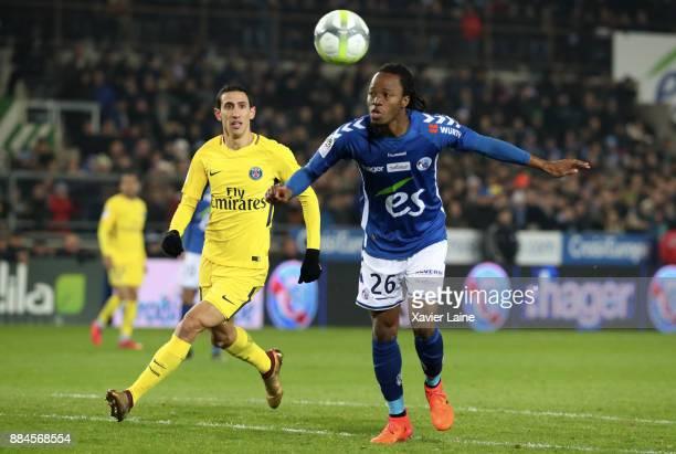 Angel Di Maria of Paris SaintGermain in action Bakary Kone of Strasbourg during the Ligue 1 match between Strasbourg and Paris Saint Germain at La...