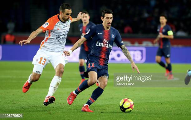 Angel Di Maria of Paris SaintGermain in action with Ellyes Skhiri of Montpellier during the Ligue 1 match between Paris SaintGermain and Montpellier...
