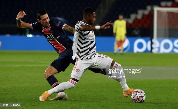 Angel Di Maria of Paris SaintGermain in action with Fred of Manchester United during the UEFA Champions League Group H stage match between Paris...