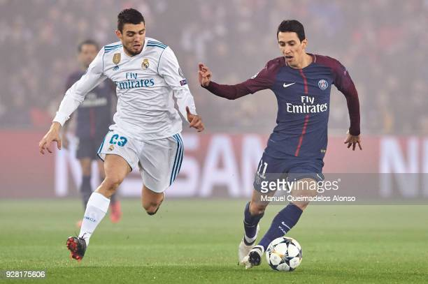 Angel Di Maria of Paris SaintGermain is challenged by Mateo Kovacic of Real Madrid during the UEFA Champions League Round of 16 Second Leg match...