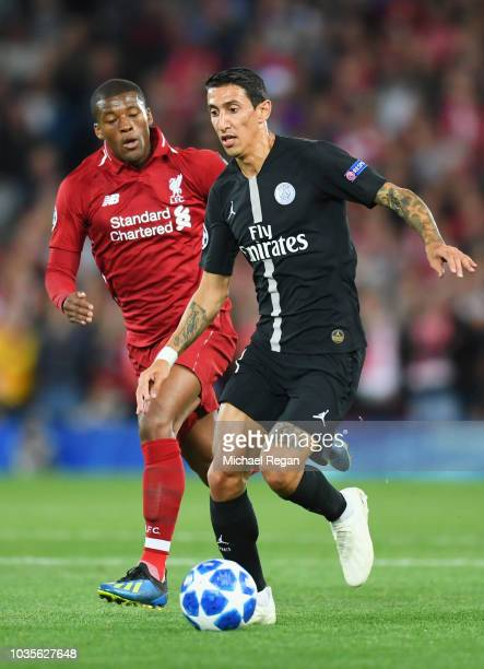 Angel Di Maria of Paris SaintGermain is chased by Georginio Wijnaldum of Liverpool during the Group C match of the UEFA Champions League between...