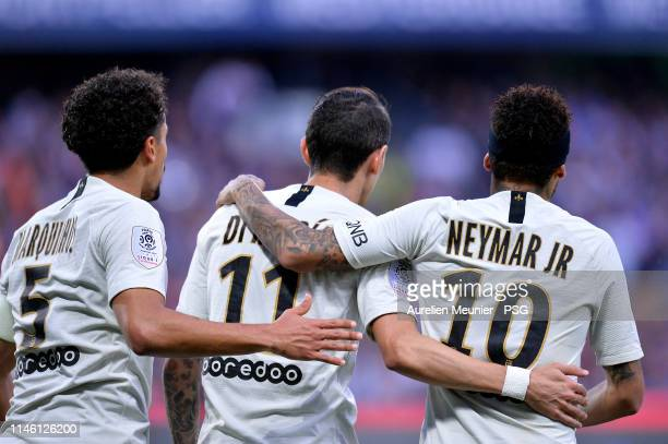 Angel Di Maria of Paris SaintGermain is congratulated by teammates Marquinhos and Neymar Jr after scoring during the Ligue 1 match between...