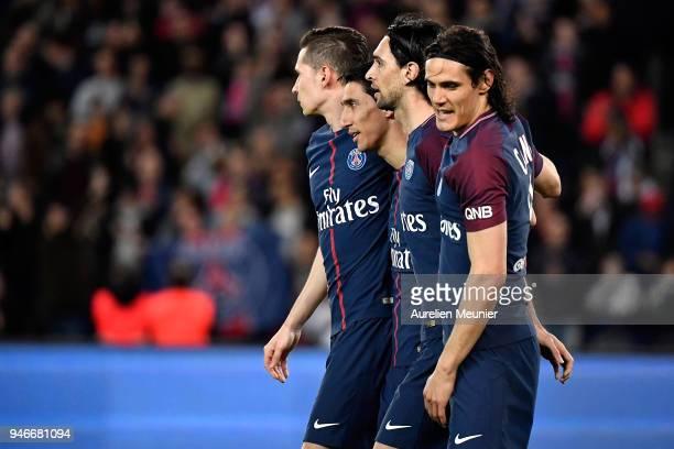 Angel Di Maria of Paris SaintGermain is congratulated by teammates Edinson Cavani Javier Pastore and Julian Draxler after his second goal during the...