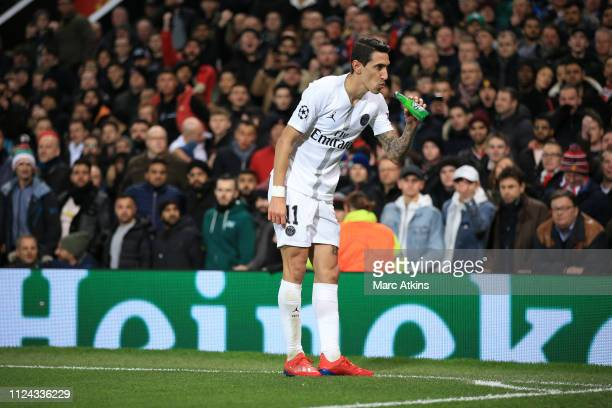 Angel Di Maria of Paris SaintGermain makes to drink from a bottle of beer thrown onto the pitch during the UEFA Champions League Round of 16 First...