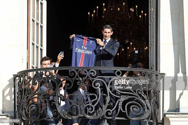 Angel Di Maria of Paris SaintGermain react with fan during his official presentation after signing for PSG at ShangriLa Hotel Paris on August 6 2015...