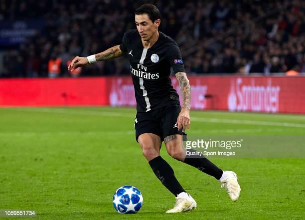 Angel Di Maria of Paris SaintGermain runs with the ball during the Group C match of the UEFA Champions League between Paris SaintGermain and SSC...