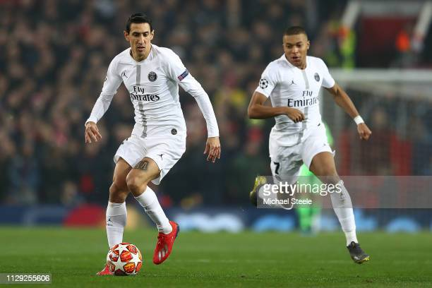 Angel Di Maria of Paris SaintGermain supported by Kylian Mbappe during the UEFA Champions League Round of 16 First Leg match between Manchester...