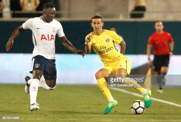 Angel Di Maria of Paris SaintGermain tries to evade Victor Wanayama of Tottenham Hotspur defends during the second half of their international...