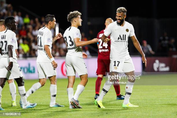 Angel Di Maria of PSG and Adil Aouchiche of PSG and Eric Maxim Choupo Moting of PSG celebrates scoring his goal during the Ligue 1 match between Metz...