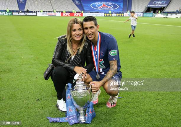 Angel Di Maria of PSG and his wife Jorgelina Cardoso celebrate the victory following the French Cup Final match between Paris Saint Germain and AS...