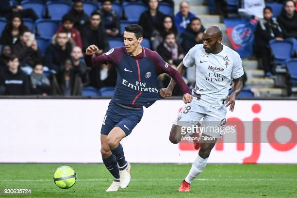 Angel Di Maria of PSG and Jonathan Rivierez of Metz during the Ligue 1 match between Paris Saint Germain and Metz at Parc des Princes on March 10...