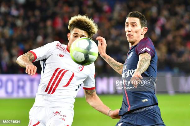 Angel Di Maria of PSG and Kevim Malcuit of Lille during the Ligue 1 match between Paris Saint Germain and Lille OSC at Parc des Princes on December 9...