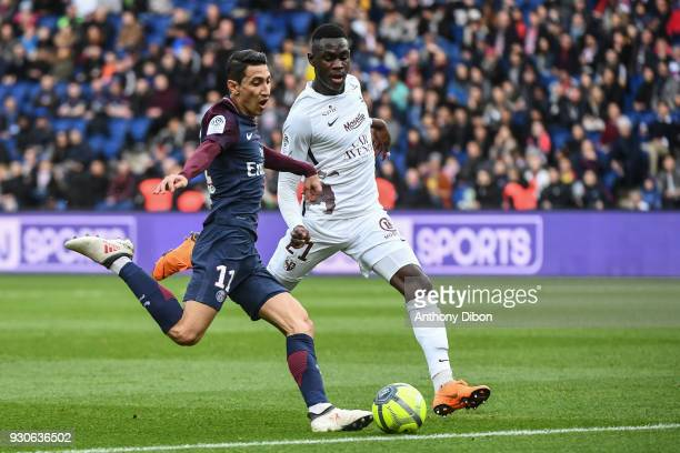 Angel Di Maria of PSG and Moussa Niakhate of Metz during the Ligue 1 match between Paris Saint Germain and Metz at Parc des Princes on March 10 2018...