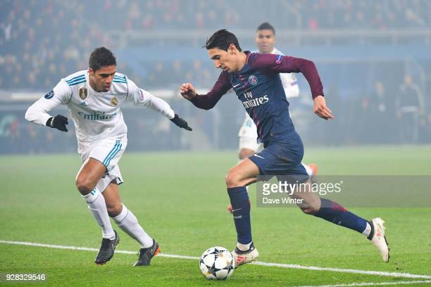 Angel Di Maria of PSG and Raphael Varane of Real Madrid during the UEFA Champions League Round of 16 second leg match between Paris Saint Germain and...