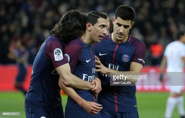 Angel Di Maria of PSG celebrates his goal between Edinson Cavani and Yuri Berchiche during the French Ligue 1 match between Paris Saint Germain and...