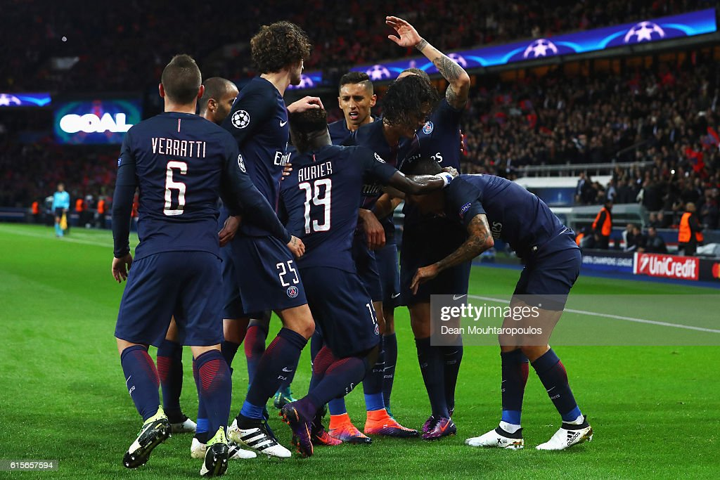 Angel Di Maria (R) of PSG celebrates scoring his teams first goal of the game with team mates during the Group A, UEFA Champions League match between Paris Saint-Germain Football Club and Fussball Club Basel 1893 at Parc des Princes on October 19, 2016 in Paris, France.